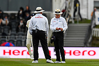 Umpires Marais Erasmus and <br /> Bruce Oxenford check out the light level, then stop play  during Day 4 of the Second International Cricket Test match, New Zealand V England, Hagley Oval, Christchurch, New Zealand, 2nd April 2018.Copyright photo: John Davidson / www.photosport.nz