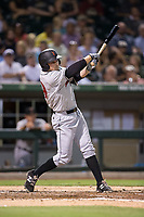 Phil Gosselin (49) of the Indianapolis Indians follows through on his swing against the Charlotte Knights at BB&T BallPark on June 16, 2017 in Charlotte, North Carolina.  The Knights defeated the Indians 12-4.  (Brian Westerholt/Four Seam Images)