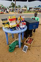 KENYA, Bukura, street vendoor selling mobile phones andre charges phones with car battery and PV module / KENIA, County Kakamega, Bukura, Markt mit Stand fuer Mobiltelefone