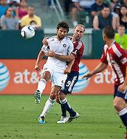 CARSON, CA – July 2, 2011: Chicago Fire midfielder Baggio Husidic (9) and Chivas USA midfielder Simon Elliott (9) during the match between Chivas USA and Chicago Fire at the Home Depot Center in Carson, California. Final score Chivas USA 1, Chicago Fire 1.