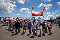 May 31, 2014; Englishtown, NJ, USA; Fans line up for the team Toyota autograph session NHRA Toyota Display on the manufacturer's midway during qualifying for the Summernationals at Raceway Park. Mandatory Credit: Mark J. Rebilas-