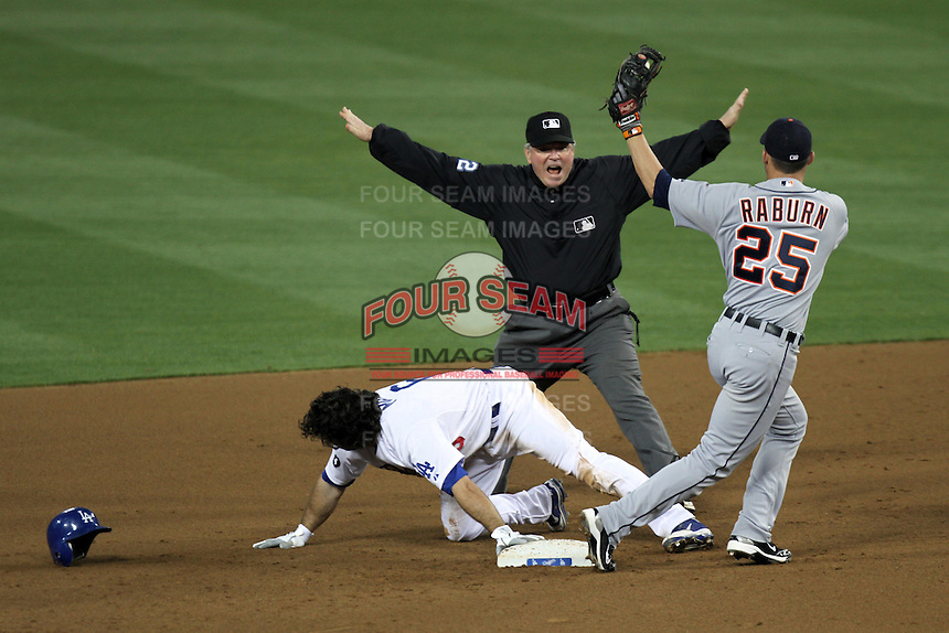 Umpire Dana DeMuth calls Los Angeles Dodgers second baseman Aaron Miles #6  safe while stealing second base ahead of the throw to Detroit Tigers second baseman Ryan Raburn #25 at Dodger Stadium on June 21, 2011 in Los Angeles,California. (Larry Goren/Four Seam Images)