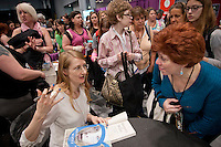 HSKU 20140531 United Stated, New York. Book Expo America, Javits Center. Finnish author Emmi Itaranta signs copies of her novel in English. Photographer: David Brabyn