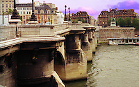 View along a bridge over the River Seine in Paris (France) in the late afternoon