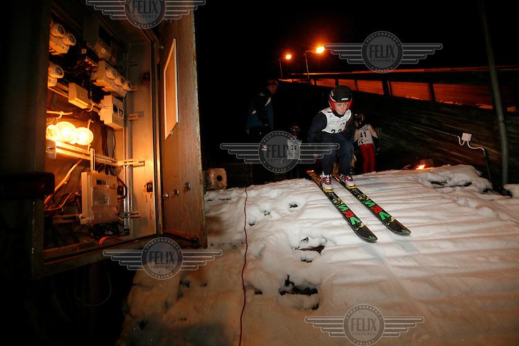 Sakarias Opshal setting off down the middle ski jump in he poorly lit Schrøderbakken ski jump.<br /> <br /> 17.01.2008