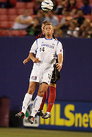 The  Wizard's Jack Jewsbury goes for a header with the MetroStars' Jeff Parke. The Kansas City Wizards were defeated by  the NY/NJ MetroStars to a 1 to 0 at Giant's Stadium, East Rutherford, NJ, on May 30, 2004.