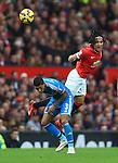 Radamel Falcao of Manchester United wins a header over Patrick van Aanholt of Sunderland - Manchester United vs. Sunderland - Barclay's Premier League - Old Trafford - Manchester - 28/02/2015 Pic Philip Oldham/Sportimage