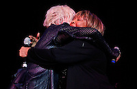 CLEVELAND - MAY 14:  Cyndi Lauper (left) and Mavis Staples share a moment during the Rock and Roll Hall of Fame 'It's Only Rock And Roll' benefit concert and Women Who Rock exhibit opening concert at the Cleveland Convention Center on Saturday May 14, 2011 in Cleveland, Ohio.  (Photo by Jared Wickerham/Jared Wickerham/Getty Images for Rock and Roll Hall of Fame and Museum)