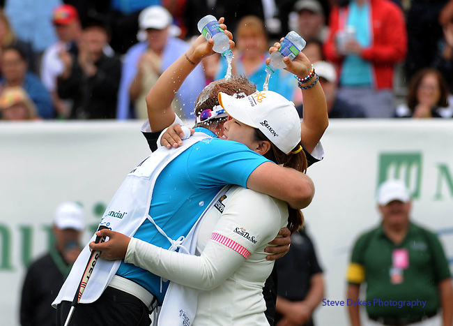 WATERLOO, ON - JUNE 8: Lydia Ko of New Zealand pours water on Inbee Park of South Korea and her caddie after Park won the Manulife Financial LPGA Classic at the Grey Silo Golf Course on June 8, 2014 in Waterloo, Ontario, Canada. (Photo by Steve Dykes/Getty Images) *** Local Caption *** Lydia Ko; Inbee Park