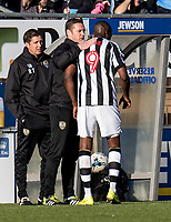 A pat on the back for goal scorer Shola Ameobi of Notts County by Kevin Nolan manager of Notts County as he is substituted during the Sky Bet League 2 match between Wycombe Wanderers and Notts County at Adams Park, High Wycombe, England on the 25th March 2017. Photo by Liam McAvoy.