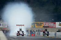 Oct. 6, 2012; Mohnton, PA, USA: NHRA top fuel dragster driver Rit Pustari (left) damaging some pistons while racing alongside Larry Dixon during qualifying for the Auto Plus Nationals at Maple Grove Raceway. Mandatory Credit: Mark J. Rebilas-
