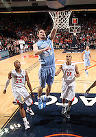 North Carolina Tar Heels forward Tyler Zeller (44) shoots in front of Virginia Cavaliers forward Akil Mitchell (25) and Virginia Cavaliers guard Malcolm Brogdon (22) during the game in Charlottesville, Va. North Carolina defeated Virginia 54-51.