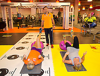 Februari 04, 2015, Apeldoorn, Omnisport, Fed Cup,  Netherlands-Slovakia, Fitness trainer  Miguel Janssen with Kiki Bertens (NED) and Michaella Krajicek (L)<br /> Photo: Tennisimages/Henk Koster