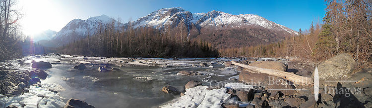 The morning sun begins to melt the springtime ice on Eagle River at Rapids Camp, near Anchorage, Alaska.