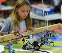 Amelia Sheehy, 9 of Middletown, Pennsylvania tests out her robot during the summer STEM (Science, Technology, Engineering and Mathematics) academy Friday July 31, 2015 at Neshaminy High School Middletown, Pennsylvania. (Photo by William Thomas Cain/Cain Images)