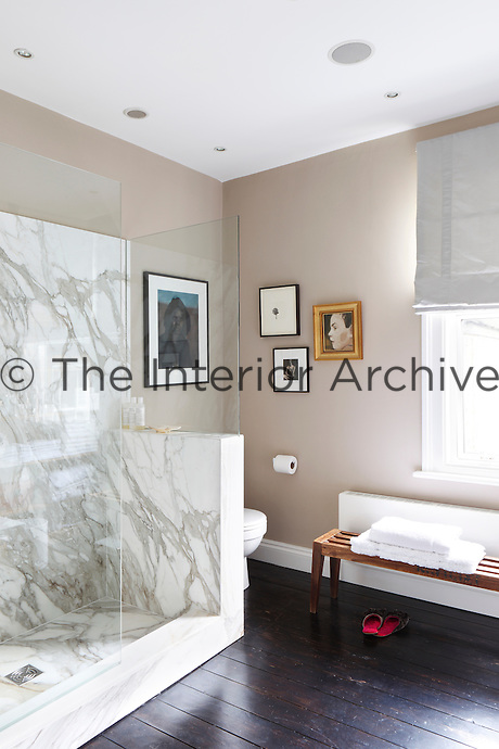 The marble-clad shower in the en-suite master bathroom adds a touch of luxury to the space