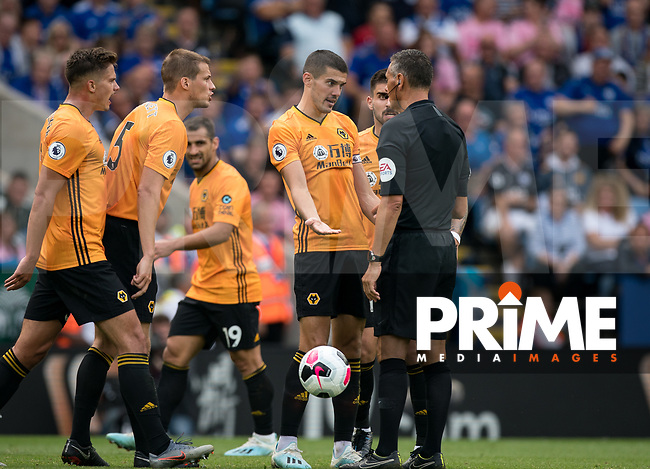 Conor Coady of Wolves and teammates complain the the Referee during the Premier League match between Leicester City and Wolverhampton Wanderers at the King Power Stadium, Leicester, England on 10 August 2019. Photo by Andy Rowland.
