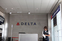 Delta Airlines logo is seen at a Detroit Metropolitan Wayne County Airport gate, Wednesday June 26, 2013.