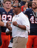 Virginia head coach Mike London reacts to a call during the game Saturday at Scott Stadium in Charlottesville, VA. Clemson defeated Virginia 59-10.  Photo/Andrew Shurtleff