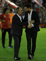 BUENOS AIRES - ARGENTINA - 02-12-2015: Eduardo Dominguez (Der.), técnico de Huracan de Argentina y Gerardo Pelusso (Izq.) técnico de Independiente Santa Fe de Colombia, durante partido de ida por la Final, de la Copa Suramericana entre Huracan de Argentina y el Independiente Santa Fe de Colombia en el estadio Tomas A Duco, de la ciudad de Buenos Aires.  / Eduardo Dominguez (R), coach of Huracan of Argentina and Gerardo Pelusso (L) coach of Independiente Santa Fe of Colombia,  during a match for the first leg for the final, between Huracan of Argentina and Independiente Santa Fe of Colombia for the Copa Suramericana in the Tomas A Duco stadium, in Buenos Aires city. Photo: Jorge Baravalle / Photogamma / VizzorImage.