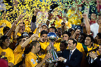 MLS Commissioner Don Garber presents the MLS Cup trophy to LA Captain Peter Vagenas. The Los Angeles Galaxy defeated the New England Revolution 1-0 in overtime at Pizza Hut Park in Frisco, Texas, Sunday, November 13, 2005.