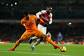 29th January 2019, Emirates Stadium, London, England; EPL Premier League Football, Arsenal versus Cardiff City; Alexandre Lacazette of Arsenal battles with Neil Etheridge of Cardiff City for the loose ball