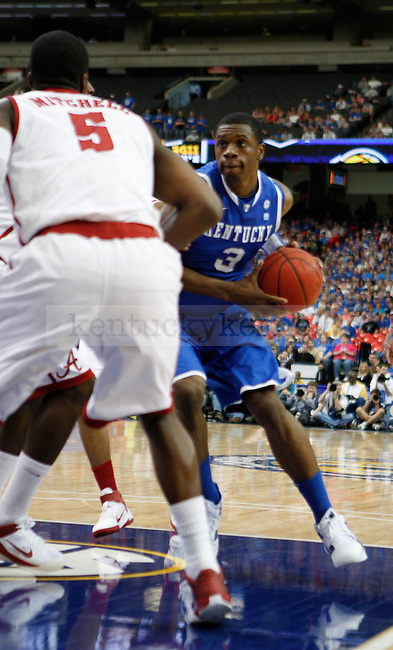 Terrence Jones drives the ball to the basket, while being guarded by Tony Mitchell, in the semifinal of the 2011 SEC Men's Basketball Tournament, at the Georgia Dome, Saturday, March 12, 2011.  Photo by Latara Appleby   Staff