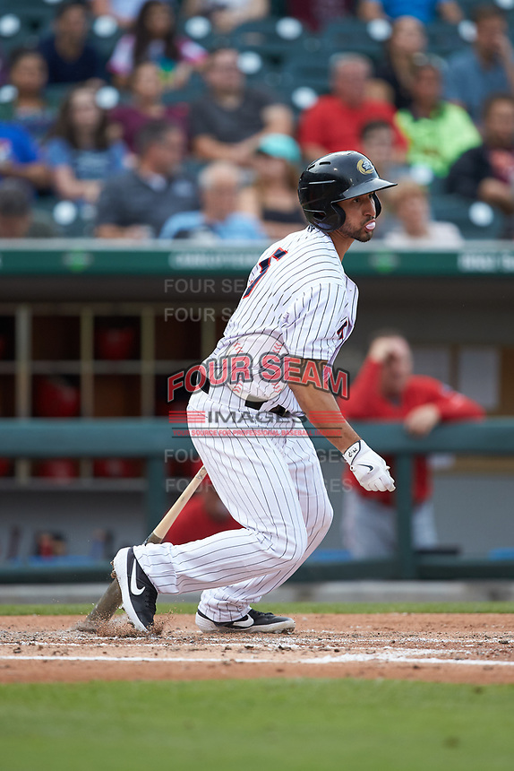 Seby Zavala (5) of the Charlotte Hornets follows through on his swing against the Louisville Bats at BB&T BallPark on June 22, 2019 in Charlotte, North Carolina. The Hornets defeated the Bats 7-6. (Brian Westerholt/Four Seam Images)