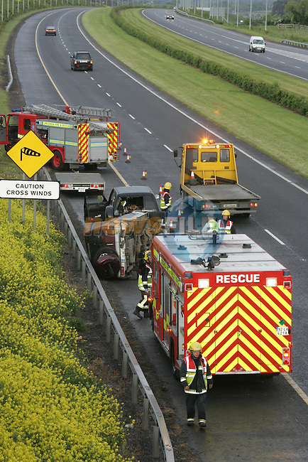 The scene of the Accident on the m1 Motorway at Drogheda. The accident involving a jeep towing a trailer with another jeep on board lost control and overturned. Two units of the Drogheda fire and rescue service attended the scene. the M1 Moterway south bound at the Donore interchange was closed for a period of time to allow the emergency services to deal with the incident..Photo: Fran Caffrey/ Newsfile.