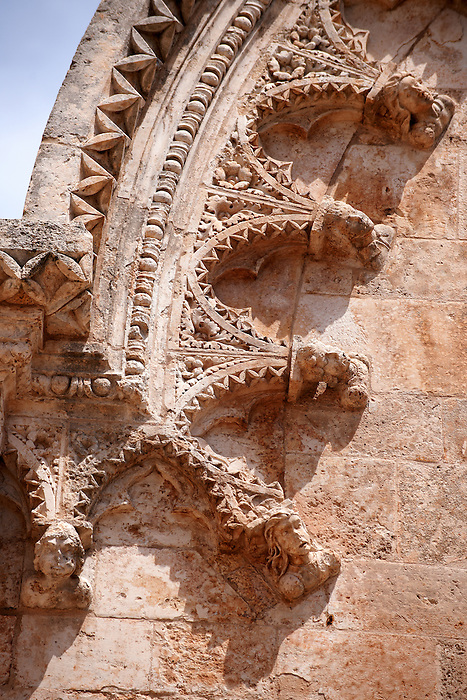 stone carvings and sculptures on the 15th century cathedral of The white city, Ostuni, Puglia, South Italy.