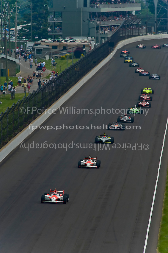 24 May, 2009, Indianapolis, Indiana, USA.Helio Castroneves (#3) leads the field up the back straight..©F. Peirce Williams 2009 USA.ref: Raw Image Capture (.NEF) available