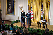 United States President Barack Obama looks on as U.S. Vice President Joe Biden speaks at an event for the Council on Women and Girls in the East Room of the White House in Washington, D.C., U.S., on Wednesday, January 22, 2014. The President signed a Presidential Memorandum at the event establishing a White House Task Force to protect students from sexual assault. <br /> Credit:  Pete Marovich / Pool via CNP