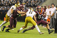 Blacksburg, VA - October 6, 2018: Virginia Tech Hokies wide receiver Eric Kumah (83) tries to avoid the tackle during the game between Notre Dame and VA Tech at  Lane Stadium in Blacksburg, VA.   (Photo by Elliott Brown/Media Images International)