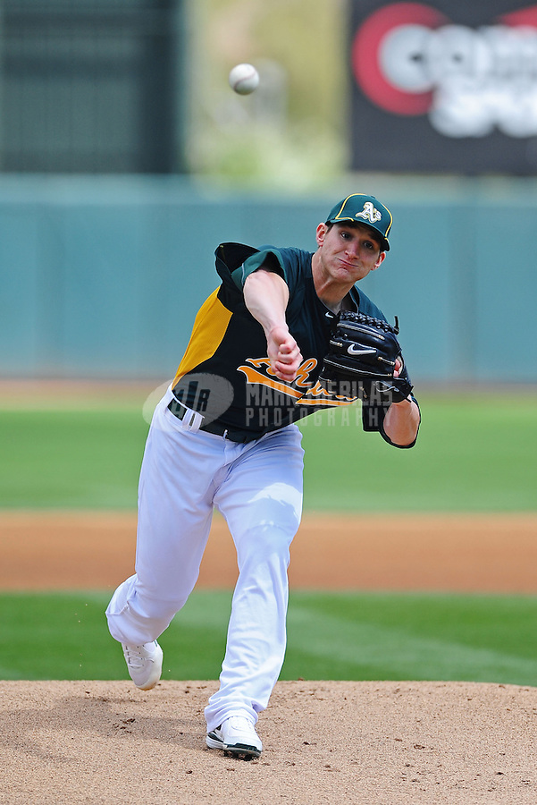 Mar. 19, 2012; Phoenix, AZ, USA; Oakland Athletics pitcher Jarrod Parker throws in the first inning against the Arizona Diamondbacks during a spring training game at Phoenix Municipal Stadium.  Mandatory Credit: Mark J. Rebilas-