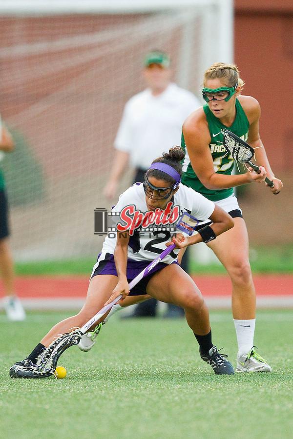Jasmine Jordan #29 of the High Point Panthers scoops up a ground ball in front of Rachel Hannon #12 of the Jacksonville Dolphins at Vert Track, Soccer & Lacrosse Stadium on March 30, 2012 in High Point, North Carolina.  The Panthers defeated the Dolphins 18-12.   (Brian Westerholt/Sports On Film)
