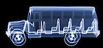 X-ray image of a school bus (blue on black) by Jim Wehtje, specialist in x-ray art and design images.
