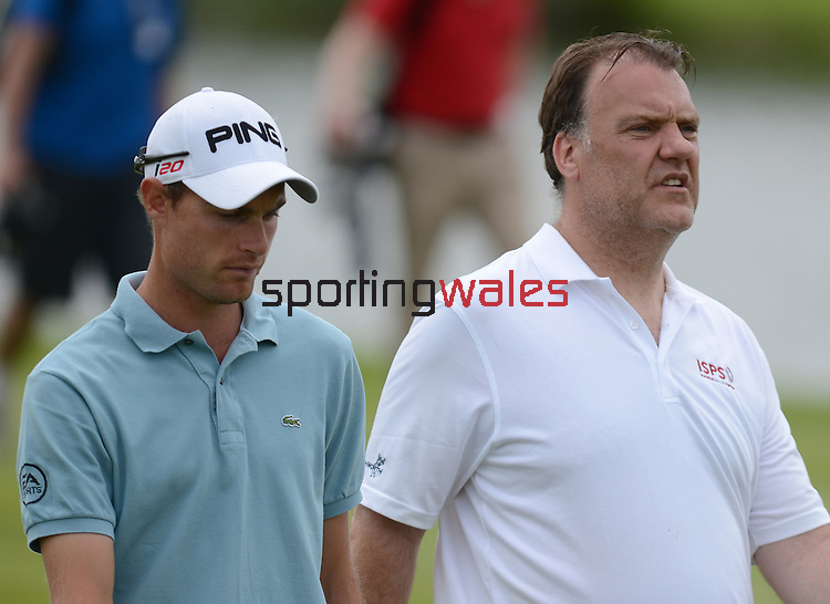 Rhys Davies and Bryn Terfel chat while playing there round...ISPS Handa Wales Open 2012 - Pro Am - Wednesday 30th May 2012 - Twenty Ten Course, Celtic Manor Resport - Newport - Wales - UK ..© www.sportingwales.com- PLEASE CREDIT IAN COOK