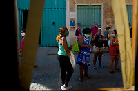 HAVANA, CUBA - MARCH 25: Women wear face mask  to prevent the spread of COVID-19 in Old Havana, on March 25, 2020. The World Health Organization declared a global pandemic as the coronavirus rapidly spreads across the world.(Photo by Eliana Aponte/VIEWpress/Corbis via Getty Images)