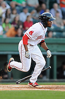 Outfielder/center fielder Manuel Margot (2) of the Greenville Drive bats in a game against the Kannapolis Intimidators on Friday, April 11, 2014, at Fluor Field at the West End in Greenville, South Carolina. Margot is the No. 13 prospect of the Boston Red Sox, according to Baseball America. (Tom Priddy/Four Seam Images)