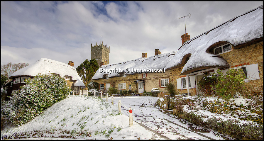 BNPS.co.uk (01202 558833)<br /> Pic: JamieRussell/BNPS<br /> <br /> ***Please Use Full Byline***<br /> <br /> Godshill, is speckled with snow.<br /> <br /> Stunning photographs have revealed a turbulent side to the normally genteel Isle of Wight.<br /> <br /> The seemingly benign south coast holiday destination has been catalogued over a stormy year by local photographer Jamie Russell, and his astonishing pictures reveal the dramatic changes in weather that roll across the UK in just 12 months.<br /> <br /> Lightning storms, ice, floods, gales and blizzards have all been captured by the intrepid photographer who frequently got up in the middle of the night to capture the climatic chaos.<br /> <br /> Looking at these pictures prospective holidaymakers could be forgiven for thinking twice about a gentle staycation on the south coast island.