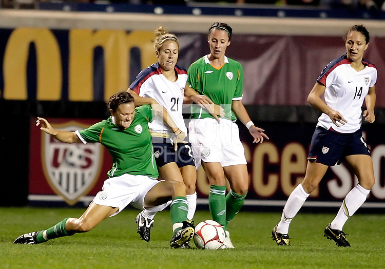 US midfielder Casey White (21) is pressured by Irish forward Michele O'Brien (left) and another Irish player as US defender Stephanie Cox (14) looks on.  The US Women's National Team defeated Ireland 2-0 at Toyota Park in Bridgeview, IL on September 20, 2008.  Photo by Tracy Allen/isiphotos.com