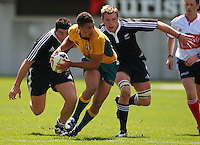 Jeff Allen and Alex Taylor close in on Mark Swanepoel during the International rugby match between New Zealand Secondary Schools and Suncorp Australia Secondary Schools at Yarrows Stadium, New Plymouth, New Zealand on Friday, 10 October 2008. Photo: Dave Lintott / lintottphoto.co.nz