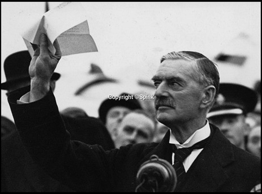 """BNPS.co.uk (01202 558833)<br /> Pic: Spink/BNPS<br /> <br /> Chamberlain waves the declaration that Hitler signed in 1938. <br /> <br /> The plane ticket wartime prime minister Neville Chamberlain used on his infamous 1938 trip to broker a peace deal with Hitler has emerged for sale for 15,000 pounds.<br /> <br /> Chamberlain waved the ticket before boarding the flight to Munich on September 29 to hold crisis talks with the Fuhrer following Germany's invasion of Czechoslovakia earlier that year.<br /> <br /> On his return to Britain the following day, Chamberlain triumphantly declared that war had been averted and he had secured """"peace for our time"""".<br /> <br /> But just a year later he was forced to make the embarrassing announcement that Britain was at war with Germany following Hitler's continued invasion of Europe.<br /> <br /> The British Airways ticket is tipped to fetch 15,000 pounds when it goes under the hammer at London auction house Spink and Son on behalf of a private collector on July 18."""