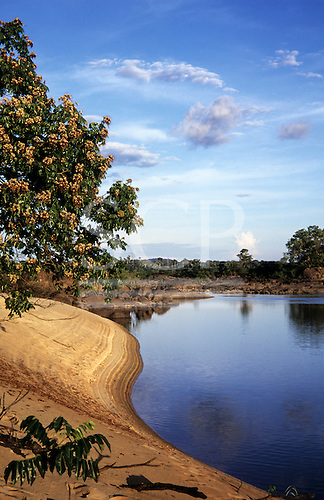 Xingu River, Amazon, Brazil. Steep sandy beach shoreline in golden evening light. Lower river levels due to climate change.