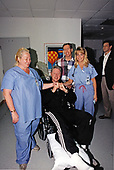 United States President Bill Clinton poses with part of the care team at St. Mary's Hospital in West Palm Beach, Florida after receiving treatment for a leg injury on March 14, 1997.  The President will undergo surgery for a torn tendon in his right knee after stumbling on steps at the Florida home of golf pro Greg Norman.<br /> Mandatory Credit: Robert McNeely / White House via CNP