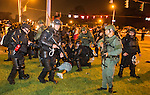 BATON ROUGE, LA -JULY 09: Baton Rouge police rush the crowd of protesters and start making arrest on July 9, 2016 in Baton Rouge, Louisiana. Alton Sterling was shot by a police officer in front of the Triple S Food Mart in Baton Rouge on July 5th, leading the Department of Justice to open a civil rights investigation. (Photo by Mark Wallheiser/Getty Images)
