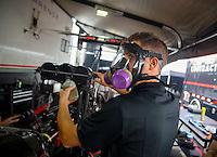 Jun 5, 2015; Englishtown, NJ, USA; Gary Pritchett , crew member for NHRA top fuel driver Steve Torrence during qualifying for the Summernationals at Old Bridge Township Raceway Park. Mandatory Credit: Mark J. Rebilas-