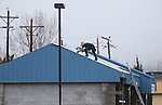 Workers repair a car wash roof damaged as another winter storm rolls through Northern Nevada, in Gardnerville, Nev. on Friday, Feb. 10, 2017.  <br /> Photo by Cathleen Allison/Nevada Photo Source