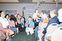 People turn towards the doors as Republican presidential candidate Dr. Ben Carson arrives to speak at a town hall campaign stop at a meeting of the Windham Republican Town Committee at the Castleton Banquet and Conference Center in Windham, New Hampshire.