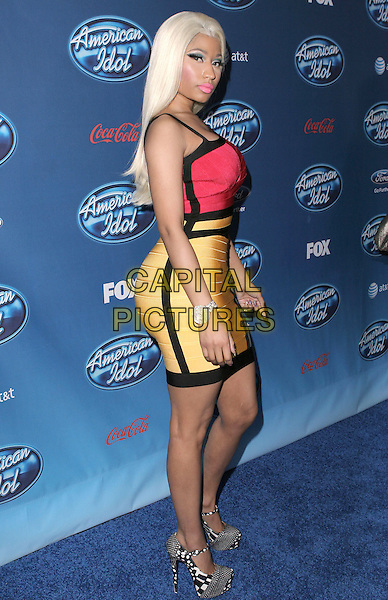 Nicki Minaj .American Idol premiere event held at Royce Hall at UCLA in Westwood, California, USA..9th January 2013                                                                   .full length red black trim dyed blonde hair yellow dress white side .CAP/DVS.©DVS/Capital Pictures.